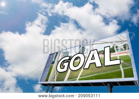 text GOAL on led scoreboard , blue sky background. sport concept