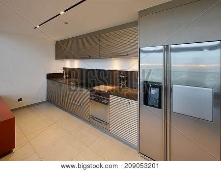 Luxury Modern Kitchen Area And Decoration At Night On Condominium, Interior Design