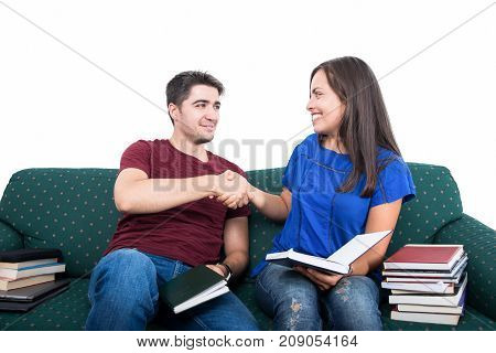 Student Couple Sitting On Couch Studding Shaking Hands
