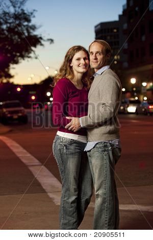Caucasian Couple Standing In Middle Of The Street
