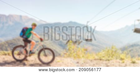 Photo of man in helmet riding bicycle