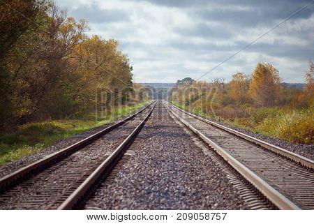 Railway two railroad tracks goes parallel horizontal shot