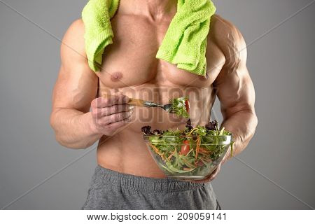 Healthy Man Eating A Salad