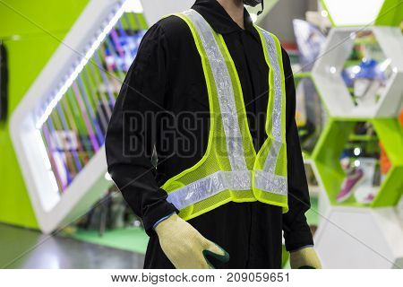 a yellow mesh safety vest with reflective tape.