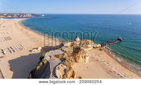 Aerial. Beach tres castelos and Rocha, in Portimao, view from the sky