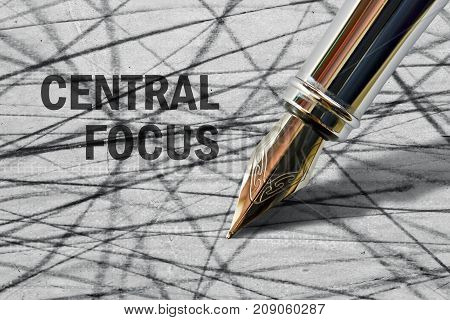 Closeup of the nib of a fountain pen and text Central Focus