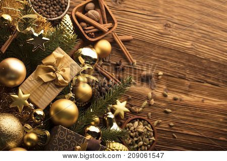 Christmas decoration in golden and brownish aesthetics with presents in boxes, golden baubles.