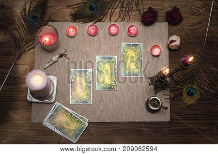 Tarot cards on wooden desk table. Fortune teller.