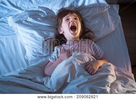 Girl 4 Years Old Screaming While Lying In Bed