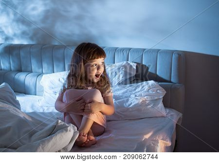 The Girl Shouts While Sitting On The Bed In The Night