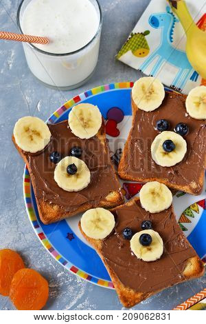 Breakfast for children - toast with chocolate paste banana and berries. Good morning!