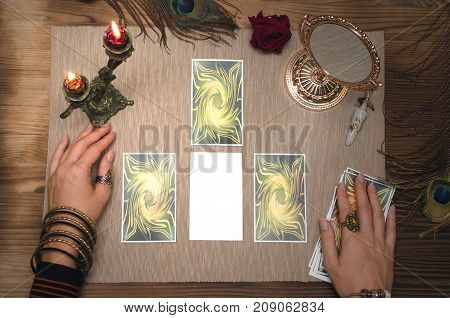 Mock up of empty tarot cards on wooden table with copy space for image or for text.
