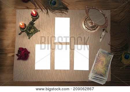 Deck of tarot cards. Mock up of tarot cards alignment on wooden table with copy space for image or for text.