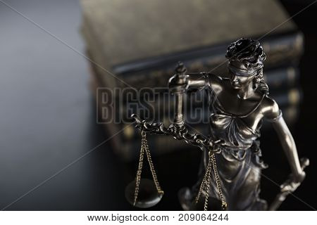 Law symbol. Statue of justice in court library.
