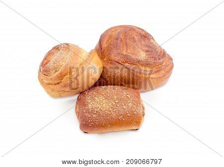 Two different sweet bread roll sprinkled with sugar and one sweet bun filled with jam on a white background