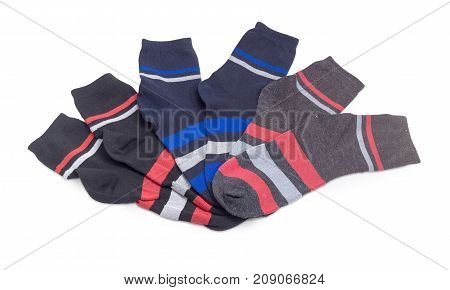 Different black men's socks with stripes on a white background