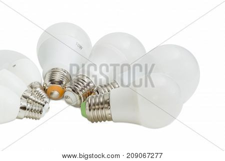 Fragment of a group of the several different domestic light emitting diode lamp with various size of a screw base on a white background