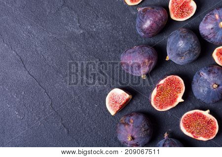 Ripe sweet figs . Healthy mediterranean fig fruit . Top view space for text