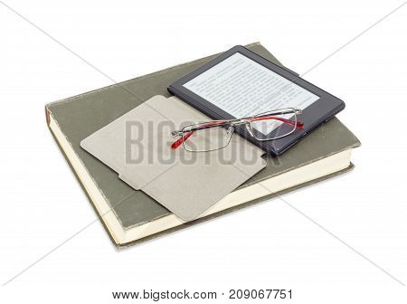 E-book reader in an open e-reader case and modern classic men's eyeglasses in metal frame on a closed ordinary paper book on a white background