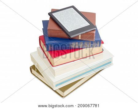 E-book reader on a stack of ordinary paper books on a white background