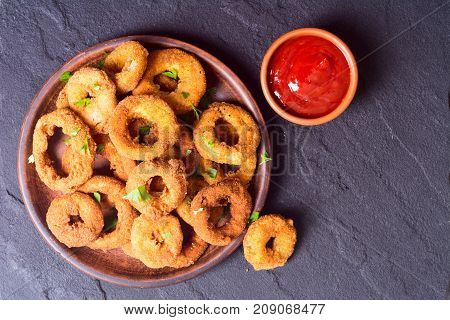 Homemade сrunchy fried onion rings with sauces
