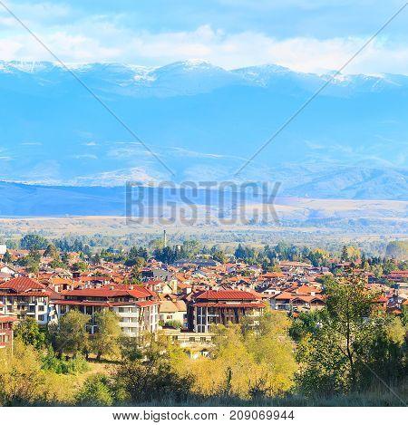 Bansko town panorama of bulgarian ski resort with snow mountain peaks, Bulgaria
