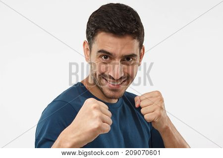 Close Up Portrait Of Smiling Young Guy Keeping His Fists Ready To Fight And Defense Himself. Strong