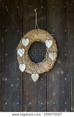 Wooden door decoration made of rope with six hearts
