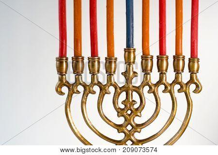 Brass hanukkah menorah with candles closeup horizontal