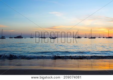 Luxury Yachts And Sunset On The Sea In Evening At Phuket, Thailand