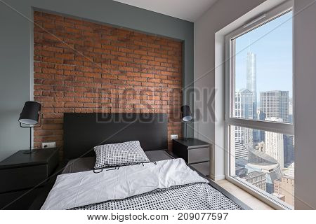Industrial Bedroom With Brick Wall