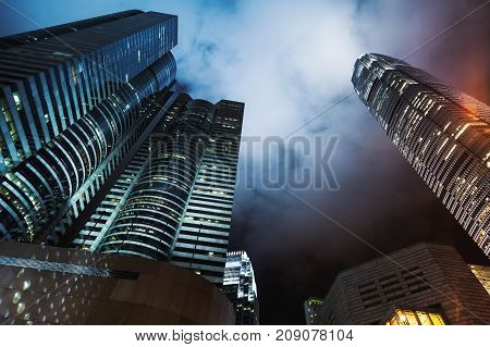 Night Skyline With Skyscrapers Under Cloudy Sky