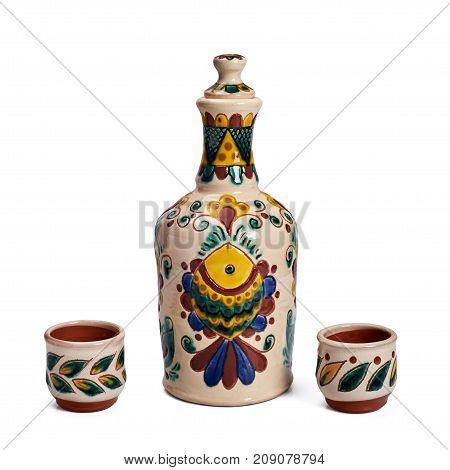 Still life with ceramic handmade bottle and cups. The bottle and the cup are painted according to the samples of the late nineteenth century in the technique Kosovo ceramics