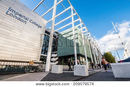 LONDON UK - 5 OCTOBER 2017: A low and wide angle view of the modern facade to the eminent London university of Imperial College known for its faculties in science engineering medicine and business.