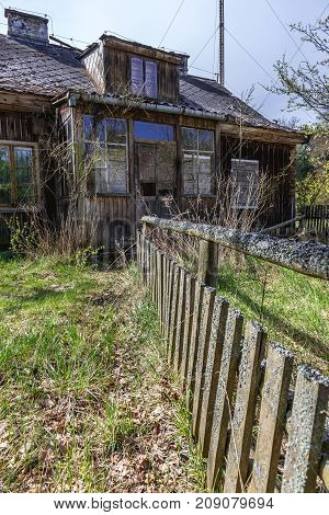 Wooden ruined cottage on a desolate farm in forest complex called Kampinos near Warsaw Poland