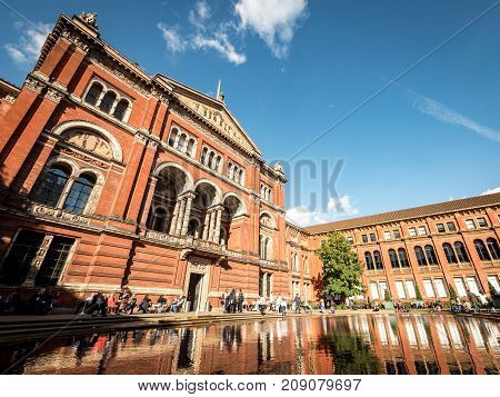 LONDON UK - 5 OCTOBER 2017: The architecture and courtyard in the centre of the V&A museum known as the John Madejski Garden dominated by a large elliptical pool.