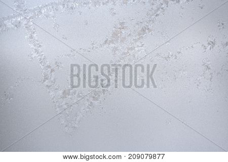 Winter Background. Textured Pattern Of Frozen Ice On Winter Window Glass And Copy Space.