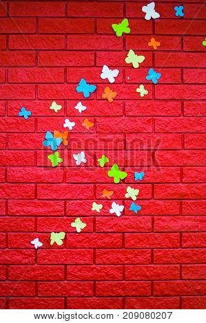 Red Brick Wall With Paper Butterflies