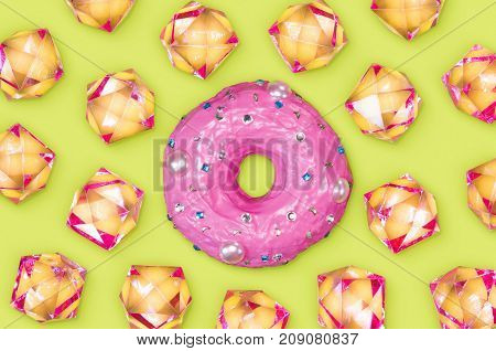 A photo of a donut with lots rhinestones around it.
