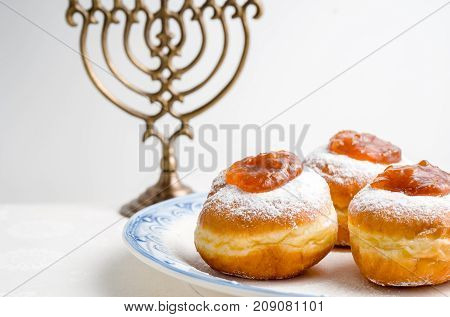 Hanukkah Minor, donuts with jam on a plate on a white background horizontal