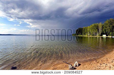Dark Storm Clouds Before Rain Above The Lake