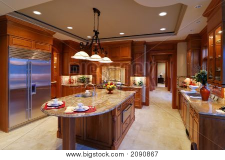 Large open kitchen in a luxury home poster