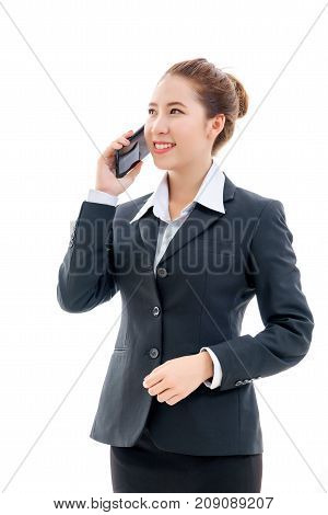 Smiling young Asian businesswoman in black suit and white t-shirt talking on mobile phone isolated on white background