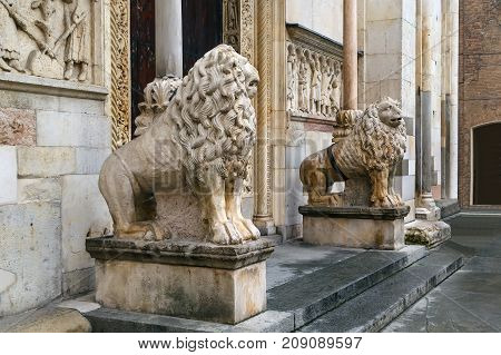 Lions statue in front of the Cathedral of Modena Italy