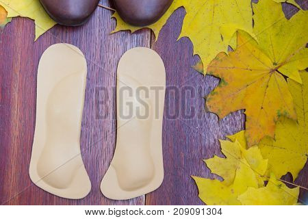 Brown Shoes With Orthopedic Insoles. Autumnal Background, Maple