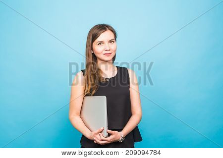 Smart beautiful young woman using laptop pc computer isolated on blue background.