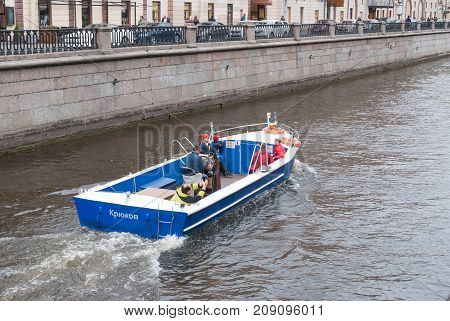 ST. PETERSBURG RUSSIA - MAY 28 2017: Pleasure boat with tourists on the Griboedov canal in St. Petersburg Russia