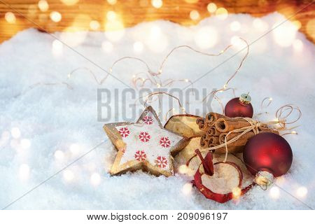 Christmas fragrance with apple rings and cinnamon sticks in snow