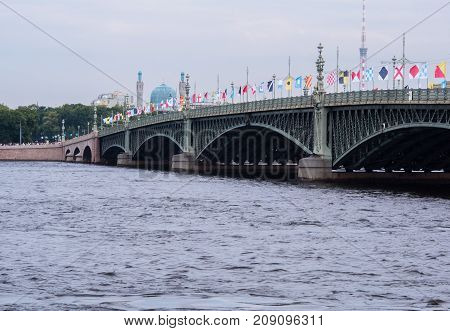 ST PETERSBURG RUSSIA - JULY 28 2017: Trinity Bridge decorated with flags in honor of the Russian Navy