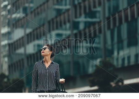 Young Businesswoman Walking Outdoors